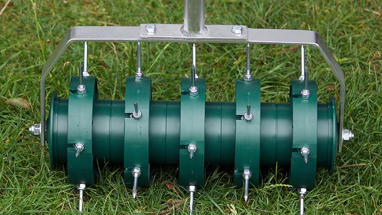 Rolling lawn aerator.